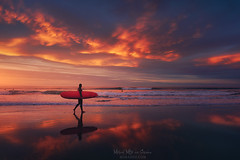 To the towel (Mimadeo) Tags: surfer sunset walking reflection beach beautiful reflections ocean sea water sport man wave coast silhouette surfboard summer surf surfing rider shoreline shore seaside sand dusk sky board clouds red blue