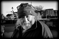 See who I saw in Southport (* RICHARD M (Over 7 MILLION VIEWS)) Tags: street portraits portraiture streetportraits streetportraiture mono blackwhite ray raywood g8lite flickrites friends photographers togs scousers scouse liverpudlians merseysiders beards bearded whiskers bewhiskered woolyhat woolenhat headgear headwear shades sunspecs sunglasses february winter wintertime wintersun sunnysouthport southport sefton merseyside wellwrappedup allwrappedup keepingwarm stayingwarm whitebeard whitewhiskers expressions