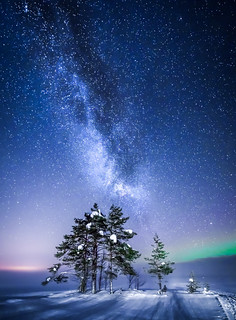 milky way above a frozen lake in Finland