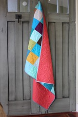 Patchwork quilt with red back (Shiners view) Tags: red back quilt patchwork modern