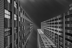 Cloud scraper (Shots in the dark) Tags: architecture longexposure blackandwhite blackwhite monochrome buildings towers clouds movement high sky amsterdam zuidas d750 leefilter 10stop bigstopper peterbijsterveldpictures