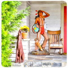 ( The prairie is calling ) (Wandering Dom) Tags: house porch rockingchair coyotte sculptures americanindian sioux people natives usa humans being animal time life reality dreams nothingness earth multiverse prairie calling roam wandering