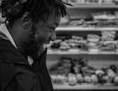 My friend finding something amusing in the drinks section :D (Latrice Grant) Tags: lightroom bnw blackandwhite northampton hometown uk nikon nikond3200 nikkor35mm 35mm 35mmlens travelphotography streetphotography shopping natural portrait dreadlocks dreads candid