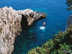Splash! (spiridono) Tags: sea beach travel coast coastline vacation rocks film croatia shore kodak seascape mamiya 645 120 medium format shoreline bay idyllic leisure riverbank horizon over water waters edge