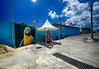 Parrot in Bridgetown, Barbados (` Toshio ') Tags: toshio barbados bridgetown caribbean parrot painting piratescove man art clouds island fujixe2 xe2 flags club
