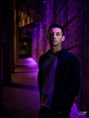 Jacob (jonlai.photo) Tags: seattle pike place street night purple neon light man male