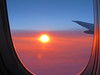 The eye of red (iolarkov) Tags: flight view sun airplane sky sunrise illuminator red