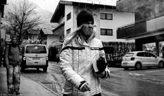 Fire and Ice (Neil. Moralee) Tags: austria2018neilmoralee neilmoralee woman lady girl mature unhappy sad street candid austria hayrehoffen cold hat fire ice black white bw bandw blackandwhite whiteandblack mono monochrome nikon d7200 tortured wild mean gloves book evil cursed neil moralee people town road winter wet damp face portrait
