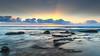Sunrise Seascape and Sun Rays (Merrillie) Tags: australia beach centralcoast clouds coast coastal crepuscularrays dawn daybreak earlymorning landscape morning nature newsouthwales nsw ocean outdoors rocks sea seascape sky sunrays sunrise toowoonbay water waterscape