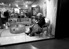 Lady to buy (Alain Rempfer) Tags: centrecommercial shoppingcenter magasin shop streetphotography candidphotography candidportrait candidsnapshot emotion face visage peopleinthestreet photoderue publicspace espacepublic scenedevie urban portraiture viequotidienne dailylife photographienonposée unposedphotography panasonicdmcsz10