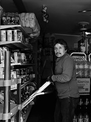 Stocking the shelves (Something Sighted) Tags: streetphotography candid scènederue blackandwhite noiretblanc newhope pennsylvania buckscounty