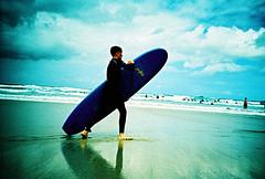 Lomo – get to grips (lomomowlem) Tags: analogue 35mm lofi beach crossprocess colourstreambrighton clouds cornwall expiredfilm kodakelitechrome lomo lomography lca sand sea surfer foamie xpro xprocess