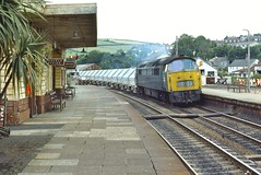 Lostwithiel UK  |  1976 (keithwilde152) Tags: br class52 westerns thousands lostwithiel cornwall uk station town platforms tracks buildings architecture gwr freight train clay hoods diesel locomotives outdoor summer