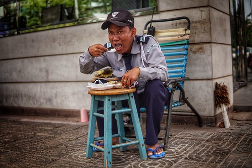 Street photography in Cambodia.... Even security guards need to eat