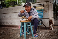 Street photography in Cambodia.... Even security guards need to eat (Ib photography uk) Tags: smile happy life food eating travel travelphotography travelling traveling adventure man person character street streetphotography streetlife streetfood streetphotographer citylife city siemreap friendly khmer sony sonyimaging sonyuk sonyasia sonycamera sonycameras sonysigma sonyshooter sonya6500 a6500 sigma sigma30mmf14 sigmalenses sigmalens ibphotographyuk ibphotography buxz77