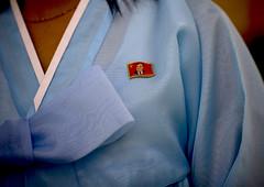 North Korean woman in choson-ot with a Kim il Sung badge, Pyongan Province, Pyongyang, North Korea (Eric Lafforgue) Tags: adult adultonly asia asianethnicity badge chosonot communism culture dictatorship dprk dprk1494 dress fashion hanbok horizontal joseonoth kimilsung koreanculture lifestyles northkorea northkorean oneperson onewomanonly people pin pins pyongyang textile tradition traditionalclothing traditionnaldress traveldestinations woman women pyonganprovince 北朝鮮 북한 朝鮮民主主義人民共和国 조선 coreadelnorte coréedunord coréiadonorte coreiadonorte 조선민주주의인민공화국 เกาหลีเหนือ קוריאההצפונית koreapółnocna koreautara kuzeykore nordkorea північнакорея севернакореја севернакорея severníkorea βόρειακορέα