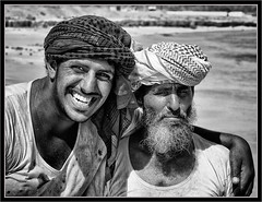 """Father & Son - Fishermen"" Shuwaymiyyah - Oman (flavius200) Tags: flavius200 dorking photocraft camera club fishing bedu bedouin arabia desert sand scrub mountain young female mono nikon d200 wilfred thesiger desolate isolated uae wife love adoration companion companionship partners respect blackandwhite black white contrast high structure"