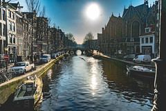 Amsterdam canal (Vuete) Tags: amsterdam bridge archbridge river canal sun sunny city street stroll strolling buildings water boats boat netherlands holland houses