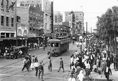 Tampa downtown on Franklin Street at the corner of Lafayette Street, with TECO street car # 12 seen heading away from the intersection in Tampa, Fl, 11-17-1922, Photo courtesy, Tampa-Hillsborough County Public Library (alcomike43) Tags: tampaflorida downtown city buildings architecture franklinstreet lafayettestreet intersection road street cityscape trolley streetcar firstnationalbank tracks rails 12 suburbanclosedstreetcar mcguirecummingsmanufacturingcompany teco tampaelectriccompany transportation vehicles automobiles trucks tourists citizens photo photograph old vintage classic bw blackandwhite brickpavedstreet historic
