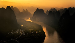 Sunrise on Li river. (Massetti Fabrizio) Tags: sunrise sun sunset cina china cambo clouds color mountain mount light landscape landscapes lliriver xianggongshan xiangtangshan xingping green guilin guangxi guanxi giallo iq180 rodenstock