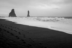 Sea stacks (timnutt) Tags: mono waves x100t blackandwhite beach ocean monochrome bw iceland fuji reynisfjara blacksand dyrholaey sea coast