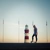 Skater Girl (Timothy Gilbert) Tags: devon lighthouse panasonic1235mmf28x girl plymouth flags panasonic smeatonstower skater gx8 thehoe