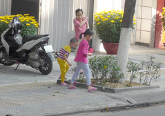 Watering the plants (Roving I) Tags: children watering plants trees flowers street danang vietnam