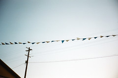 (Alyson Bowen) Tags: pdx 35mmfilm summer portland filmisnotdead istillshootfilm colorfilm olympusstylus sky flags powerlines