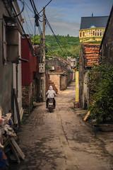 Alleyway (lgflickr1) Tags: hanoi vietnam vietnamese scooter northvietnam person overcast street southeastasia village road