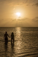 Until the day's end (joko2190) Tags: handholding gulf bay ocean couple people largo key sunset beach