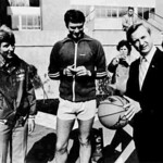 "Women's basketball coach Kay Yow (left) oversees a ""tip off "" between alumni Raleigh Mayor Smedes York and North Carolina Gov. James Hunt (right) in front of DH Hill Library. (Photo by Simon Griffiths)"