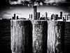 Three Posts at Pier A (Feldore) Tags: newyork skyline skyscrapers posts juxtaposition manhattan jersey feldore mchugh em1 olympus 1240mm pier a battery park wooden piles