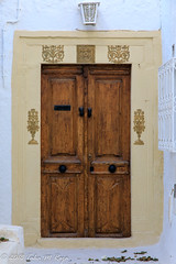 Decorative Doors of Tunisia (taharaja) Tags: ancient arabic architectural curio decorative designs doors fatemid islamic mahdia monastir northafrica olddoors qayrawan sousse tunis tunisia vintage wooden colorful flowers mediterranean