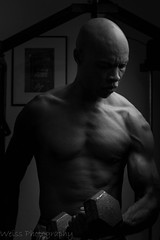 The Workout (tshabazzphotography) Tags: portrait solo weights workout blackandwhite bw monochrome lighting dark black male bald focus training shredded cuts muscle pecs biceps anatomy home canon