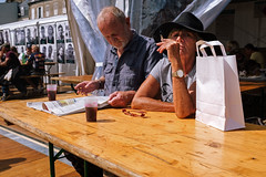 Busted (Ktoine) Tags: couple old beard hat heat summer holiday granville normandy newspaper paper bag smoking smoke cigarette wtf busted candid street