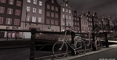 bicycles in the city (mrjulessixpence(bloggers do not follow me,unless y) Tags: water lamps city stores scenery shadow bicycle night secondlife