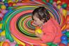 wow! (devonpaul) Tags: ball balls fun sitting yellow orange red blue colours vibrant girl peach knitted wool