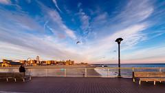 Late Afternoon, Coney Island Pier (deepaqua) Tags: lunapark goldenhour sand winter bench streetlamp lenstagger amusementpark ocean boardwalk cloud bird atlanticocean offseason seagull pier coneyisland beach