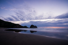 Piha Beach (Daniel Talbot) Tags: auckland aucklandregion newzealand northisland pihabeach teikaamāui beach cloud clouds colours dogdays dusk evening longexposure mirror mirrored nightfall ocean oceania oceans purple reflection sea seas season seasons sky summer summertide summertime sunset sundown sunnyseason twilight water waves weather