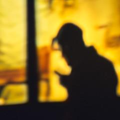 Solitary Soul Calling a Friend (Astroredg) Tags: man homme silhouette portrait phone manonphone autéléphone atmospheric ambiance night nuit shadow ombre téléphone mobile cellulaire cellular isolation solitude loneliness desolation golden yellow warm chaudjaune or color couleur solitary takumar fotodiox