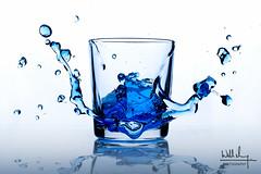 Blue Water Splash (Will M. Photography) Tags: strobe splash studio broncolor ice cube glass droppingice indoors