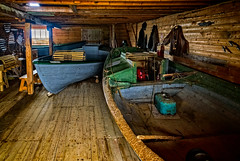 Fishing dories and lobster traps in the store (fisherman's waterfront building for processing fish and storing gear) (Brett of Binnshire) Tags: historicbuilding powerboat industry broompoint hdr commercialfishingboat boat lrhdr lightroomhdr highdynamicrange locationrecorded shed grosmornenationalpark architecture newfoundland manipulations commercialfishing equipment canada