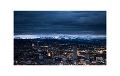 light strap (kevinaki) Tags: zurich clouds mountains city light snow horizon weid hometown sky twoworlds darkness ngc