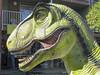 Dino Smile (cobalt123) Tags: 2018 arizona canong10 february3 hoteltucsoncitycenter jpg tucson tucsoncitycenter tucsongemandmineral virginia age11 dinosaur editedbybjb sculpture photobyvirginia westwardlookresort