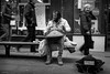 Handpan (Silver Machine) Tags: winchester hampshire streetphotography street streetportrait streetperformers handpan thehang bench sitting musician streetmusician dreadlocks walking outdoor mono monochrome blackwhite bw fujifilm fujifilmxt10 fujinonxf35mmf2rwr