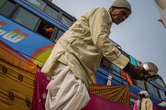 Droplets (SaumalyaGhosh.com) Tags: droplet droplets people color india bus kolkata man water street streetphotography