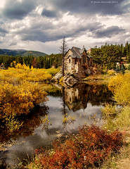 Saint Malo's Chapel on the Rock, Allenspark, Colorado with autumn colors (Brian Kermath (e.h.designs)) Tags: church chapelontherock allensparkcolorado autumncolors sky clouds landscape reflections reflection pondripples fallcolors water pond autumn stream creek stonebuilding stonechurch saintmaloschapel saintmaloschapelontherock saintmalos chapel mountains yellow golden storm darksky stormclouds allenspark colorado forest