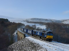 66305 4D47 Tescos at Slochd, 14th Feb 2018 by Dunks railway pix - 66305 drops down from Slochd summit and over Slochd viaduct with 4D47, the 13:05 Inverness to Mossend Tesco company train on the 14th of February 2018.
