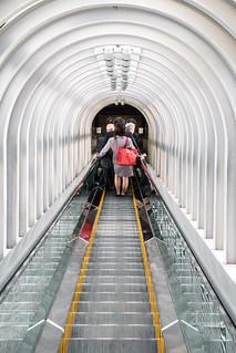 Woman on escalators at the Umeda Sky Building, Osaka - Japan