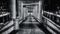 The Deep End (sdupimages) Tags: walkway noirblanc blackwhite street rue station gare tunnel couloir bw nb london londres eurostar train shadow ombre light perspective dark night nuit